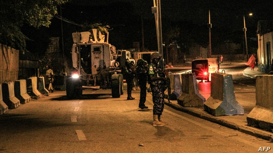 FILE - Police officers of the African Union's peacekeeping mission in Somalia (AMISOM) patrol on a street in Mogadishu, Somalia, Sept. 17, 2019. The country is bracing for attacks by the al-Shabab terror group during upcoming elections.
