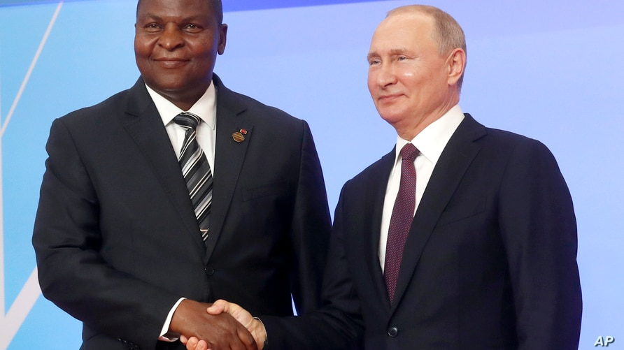 FILE - Russian President Vladimir Putin, right, and President of the Central African Republic Faustin Archange Touadera pose for a photo during a welcome ceremony of the Russia-Africa summit in the Black Sea resort of Sochi, Russia, Oct. 23, 2019.