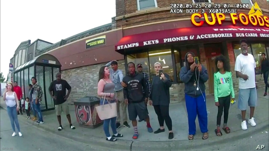 FILE - This May 25, 2020, file image from a police body camera shows bystanders including Darnella Frazier, third from right…