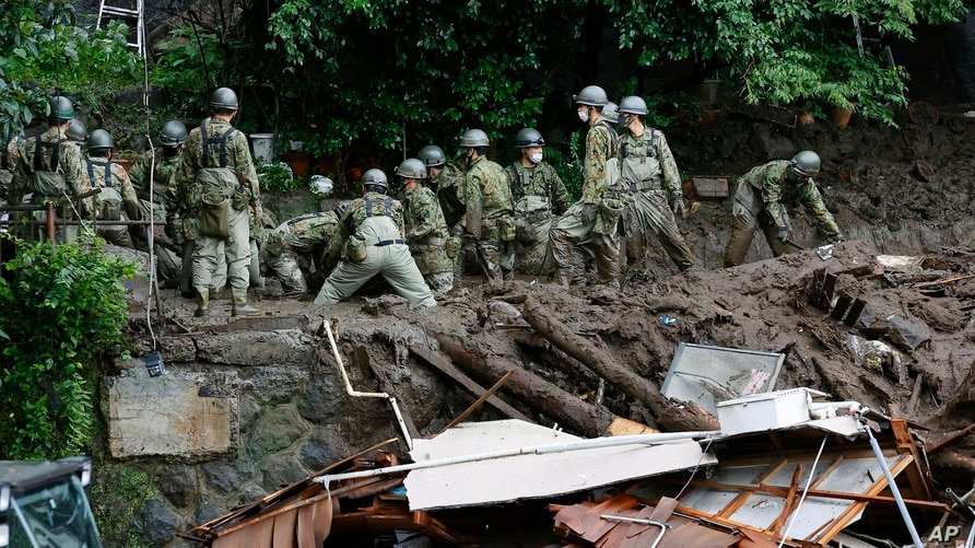 Rescuers continue a search operation at the site of a mudslide at Izusan in Atami, Shizuoka prefecture, southwest of Tokyo.
