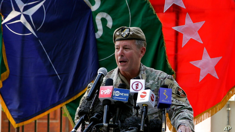 U.S. Army Gen. Scott Miller, the top U.S. commander in Afghanistan, speaks at a ceremony where he relinquished his command, at…