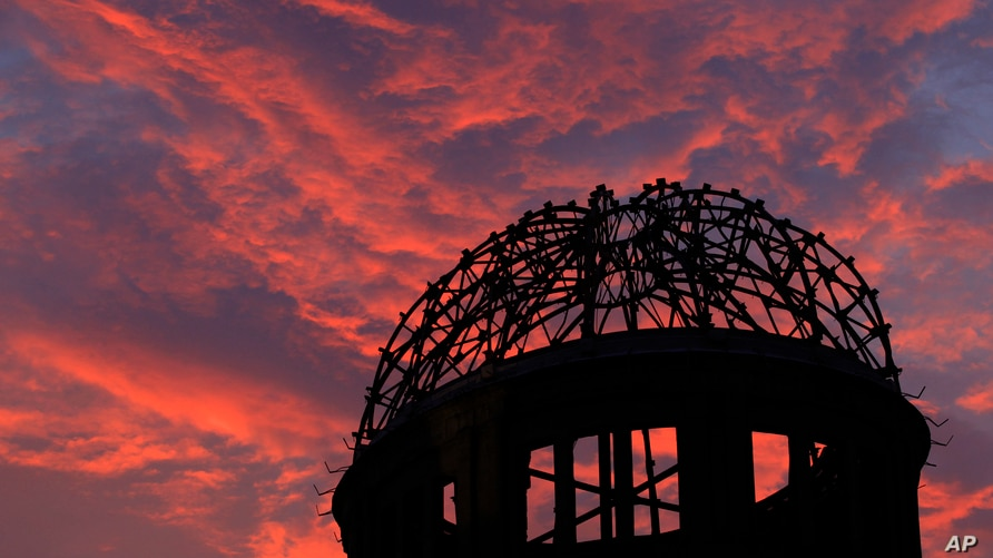 FILE - In this Aug. 5, 2013, file photo, the Atomic Bomb Dome is silhouetted at sunset in Hiroshima, western Japan. Many…