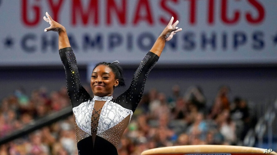 FILE - In this Sunday, June 6, 2021 file photo, Simone Biles celebrates after competing in the vault during the U.S. Gymnastics…