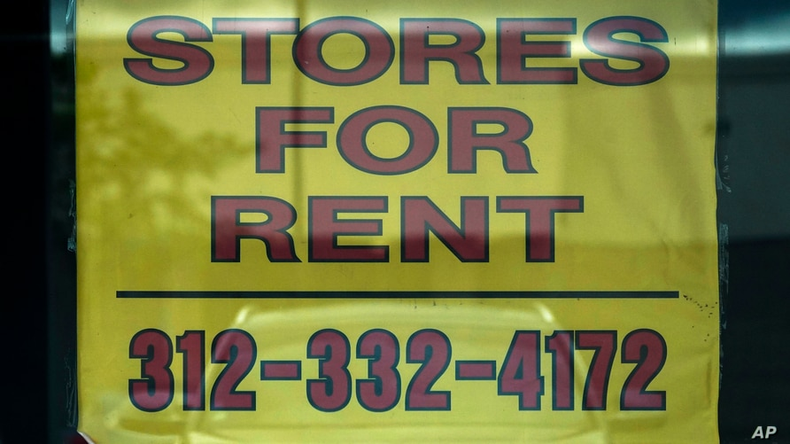 A stores for rent sign is displayed at an empty store in Buffalo Grove, Ill., July 15, 2021.
