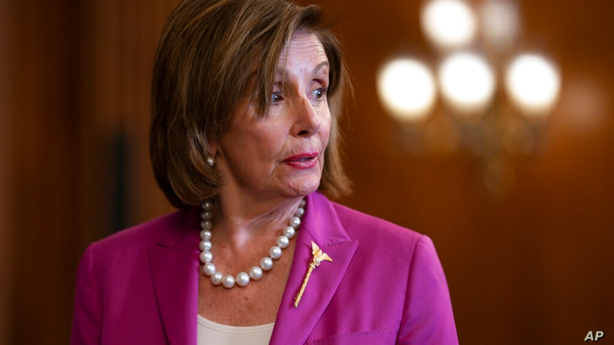 Speaker of the House Nancy Pelosi, D-Calif., attends a bill enrollment for funding crime victims, at the Capitol in Washington,…