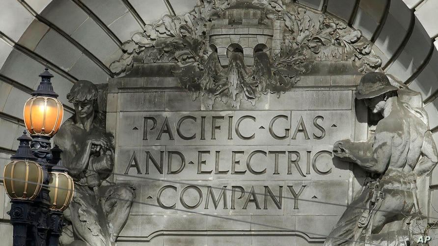 FILE - In this Oct. 10, 2019, file photo, a Pacific Gas & Electric sign is shown outside of a PG&E building in San Francisco…