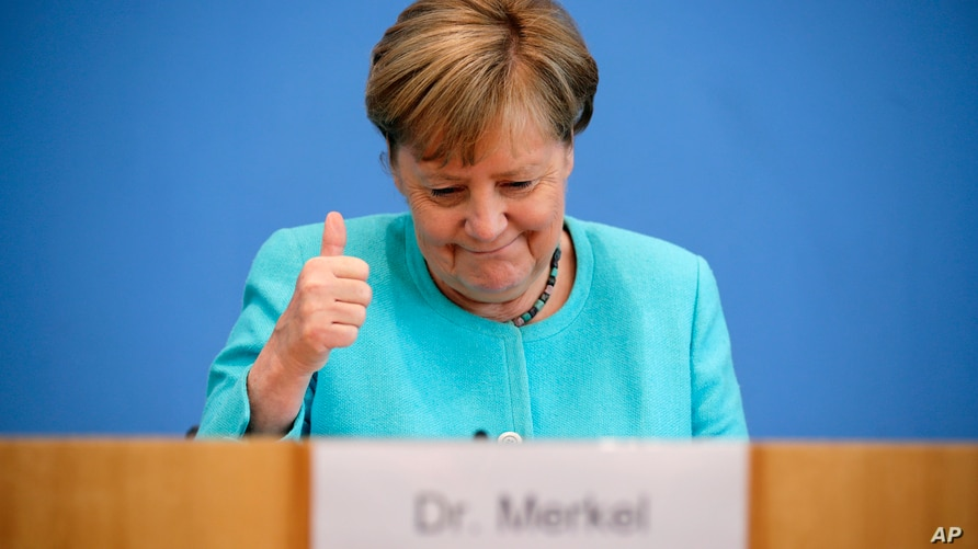 German Chancellor Angela Merkel, getures as she holds her annual summer news conference in Berlin, Germany, Thursday, July 22,…