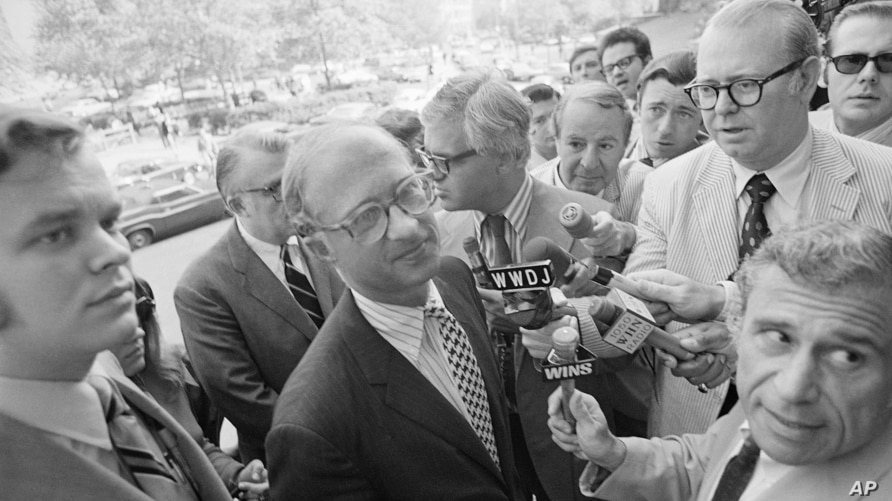 New York Times Vice President and General Counsel James C. Goodale, stripped shirt, is beseiged by reporters, June 17,1971 on…