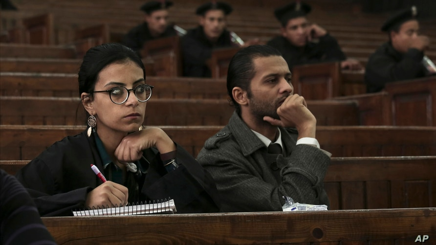 FILE - Mahienour el-Masry, an activist and lawyer, takes notes during a trial in Cairo, Egypt, Dec. 4, 2014. Egyptian authorities released three activists, including el-Masry, and three journalists, July 18, 2021, after months in pre-trial detention.