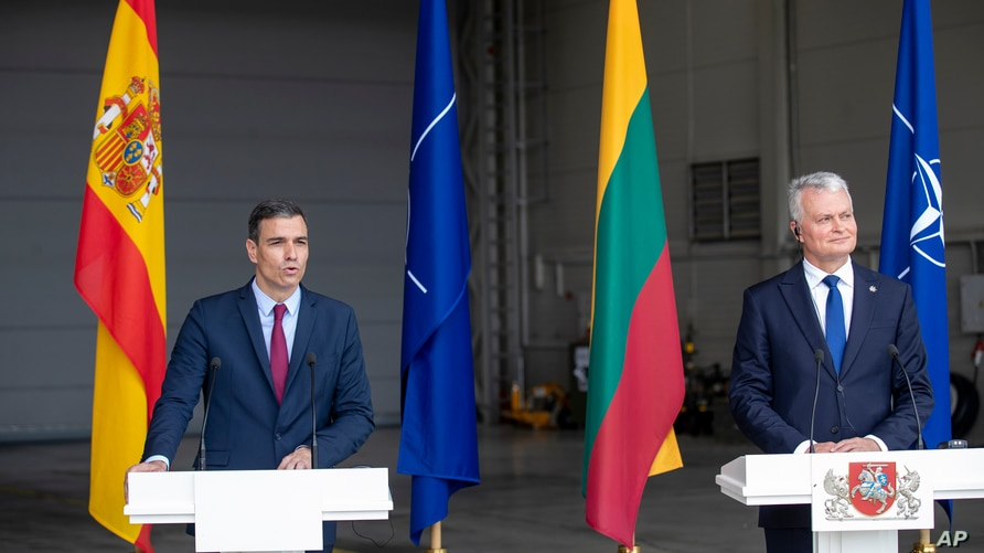 Lithuania's President Gitanas Nauseda, right, and Spain's Prime Minister Pedro Sanchez answers questions during a meeting with the press at Siauliai air force base, some 220 kms east of the capital Vilnius, Lithuania, July 8, 2021.