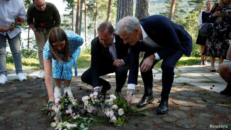 Leader of AUF Party in Norway Astrid Hoem, Swedish Prime Minister Stefan Lofven, and leader of the Norwegian Labor Party Jonas Gahr Store lay flowers at the memorial on Utoeya island to mark the 10th anniversary of the terrorist attack, July 21, 2021.