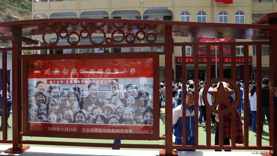 A picture of Chinese President Xi Jinping is seen at a primary school near Yangjialing Revolutionary Site, ahead of the 100th…