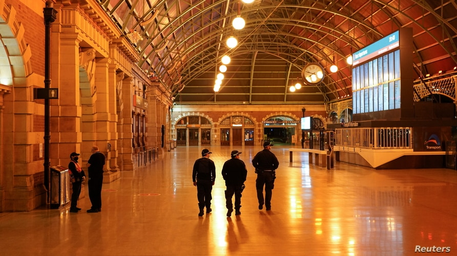 Police officers patrol through the quiet Central Station in the city center during a lockdown to curb the spread of COVID-19 outbreak in Sydney, Australia, Aug. 12, 2021.