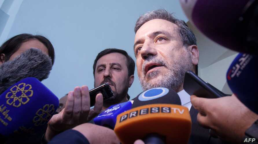 Abbas Araghchi, political deputy at the Ministry of Foreign Affairs of Iran talks to the press at the end of a meeting of the Joint Commission of the Joint Comprehensive Plan of Action (JCPOA) attended by the E3+2 (China, France, Germany, Russia,…