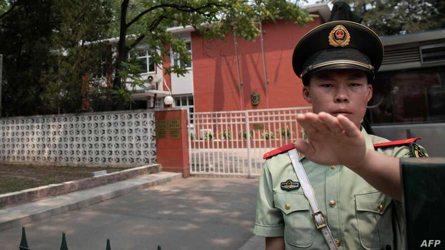 A paramilitary police officer outside the Belgium embassy in Beijing, June 19, 2019. A Belgian diplomat was to travel to China's Xinjiang region to confirm the whereabouts of a Uighur family escorted from the embassy in Beijing by police last month.