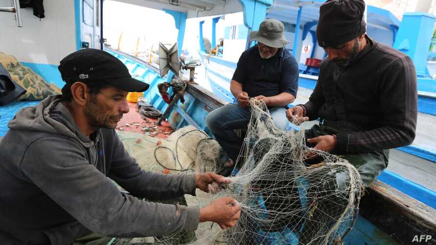 Tunisian fishermen prepare their nets in Zarzis, Tunisia, May 21, 2019. Tunisian fishermen are more involved in rescuing migrants because of the difficulties of NGOs in the Mediterranean and the disengagement of European military ships.
