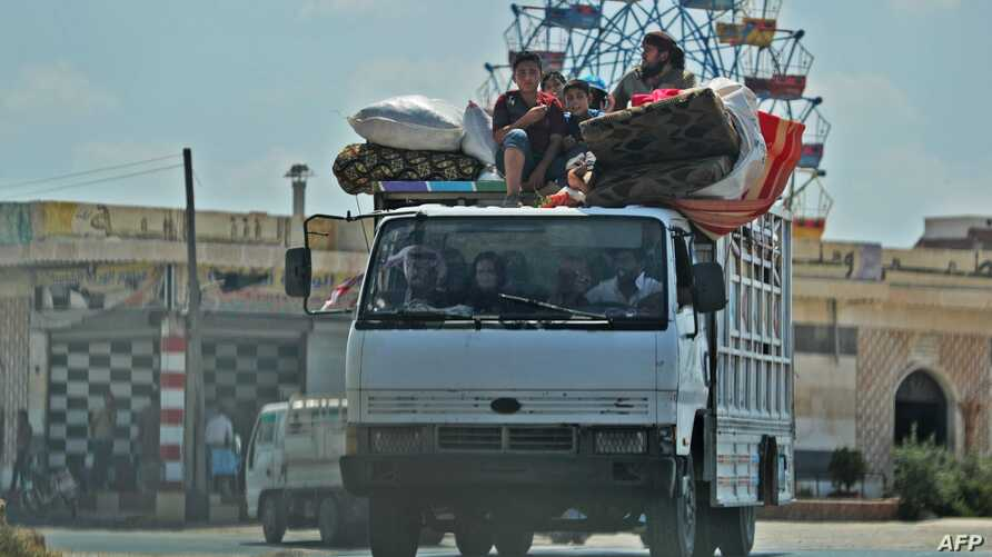 TOPSHOT - Syrian civilians flee on August 22, 2019 a conflict zone in Syria's rebel-held northwestern region of Idlib, where government bombardment has killed hundreds since late April, near Maar Shurin on the outskirts of Maaret al-Numan. Damascus…