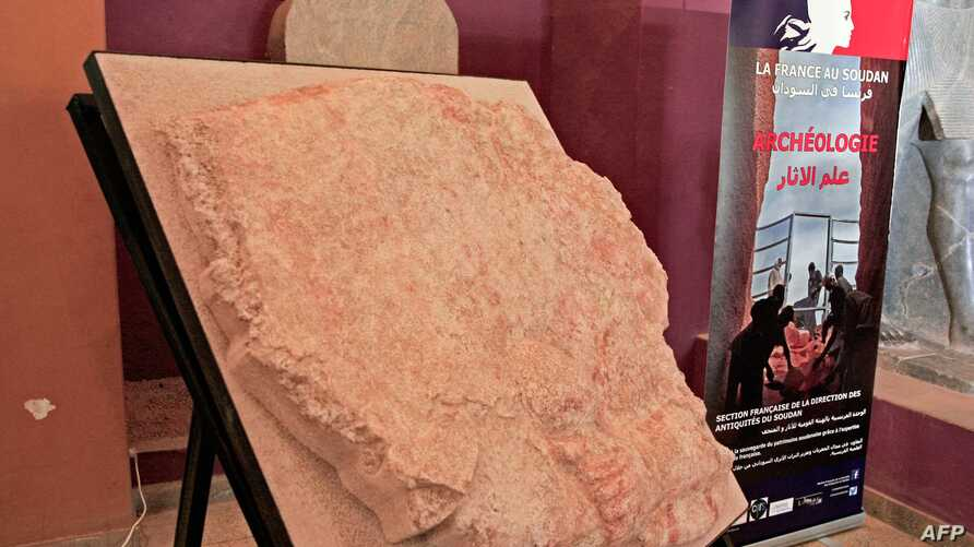 A wall painting of an ancient Kandaka Nubian queen, discovered at El-Hassa site, is displayed at the National Museum of Sudan in Khartoum on September 19, 2019. A team of French diggers has restored three Sudanese artefacts, including a 3,500-year…