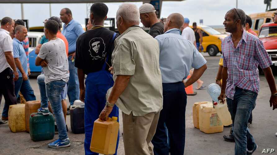"Cubans queue to buy fuel at a gas station in Havana, on September 12, 2019.  President Miguel Diaz Canel blamed the United States on Wednesday for Cuba's fuel shortage. In his address, he said the ""low availability of diesel"" will affect transport,…"