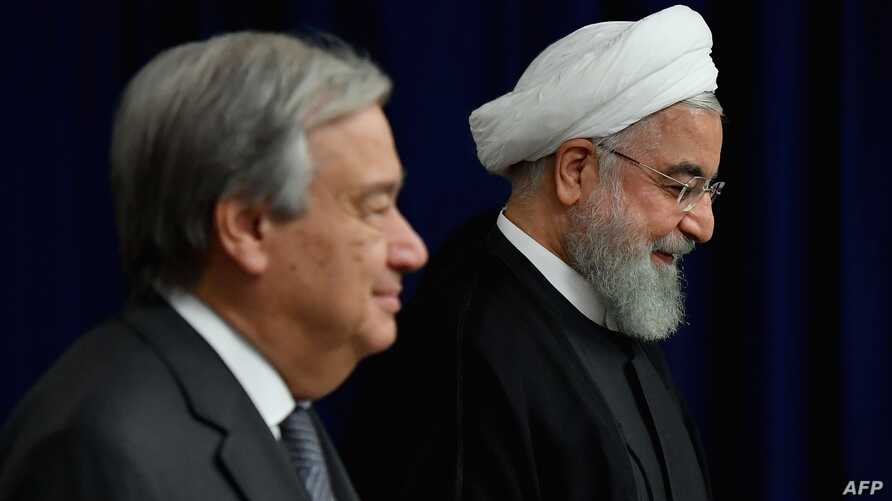 President of Iran Hassan Rouhani (R) meets with United Nations Secretary-General Antonio Guterres at the United Nations in New York on September 25, 2019. / AFP / Angela Weiss