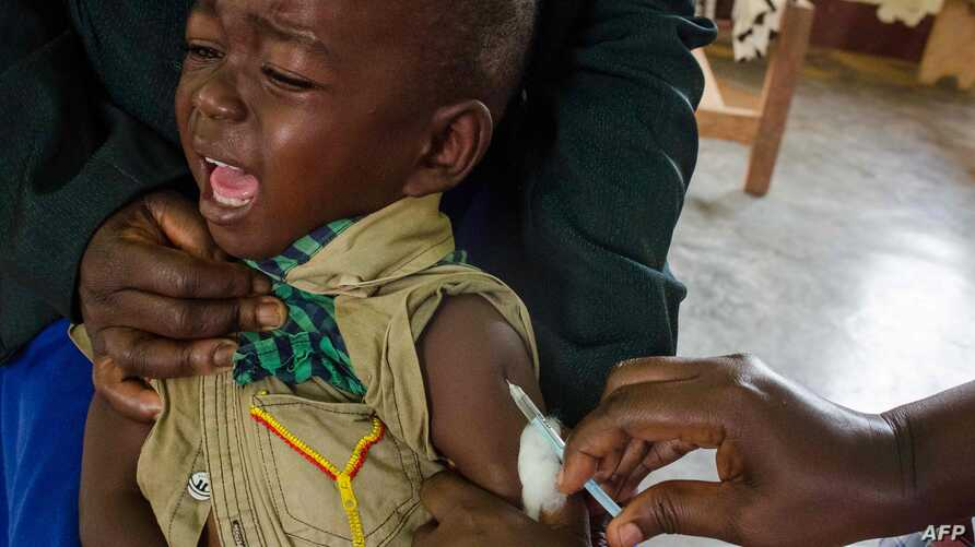 A child reacts as he receives an injection during the nationwide vaccination campaign against measles, rubella and polio…