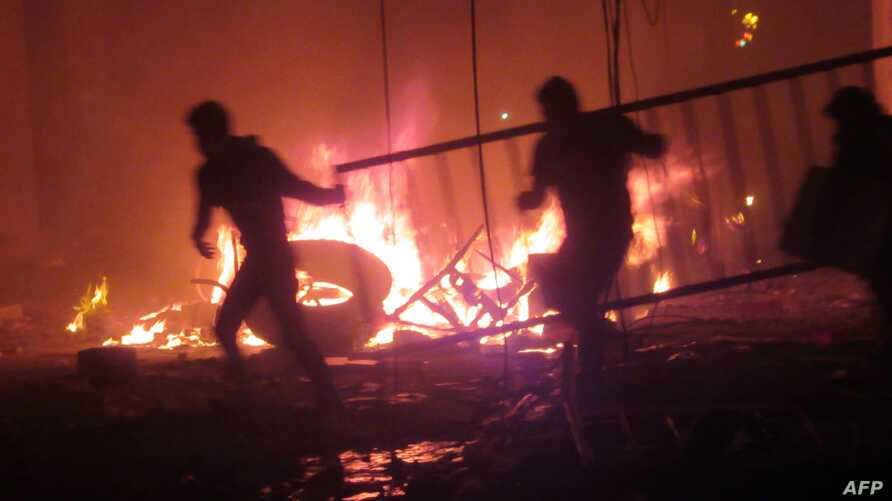 Bolivian opposition protestors set on fire the electoral offices in Sucre, Oct. 21, 2019.