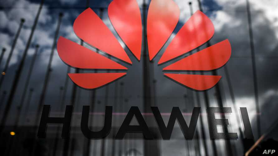 (FILES) In this file photo taken on November 6, 2019 the logo of Chinese telecom giant Huawei is pictured during the Web Summit…