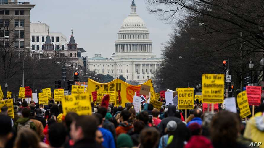 Anti-war activist march from the White House to the Trump International Hotel in Washington, DC, on January 4, 2020. -…