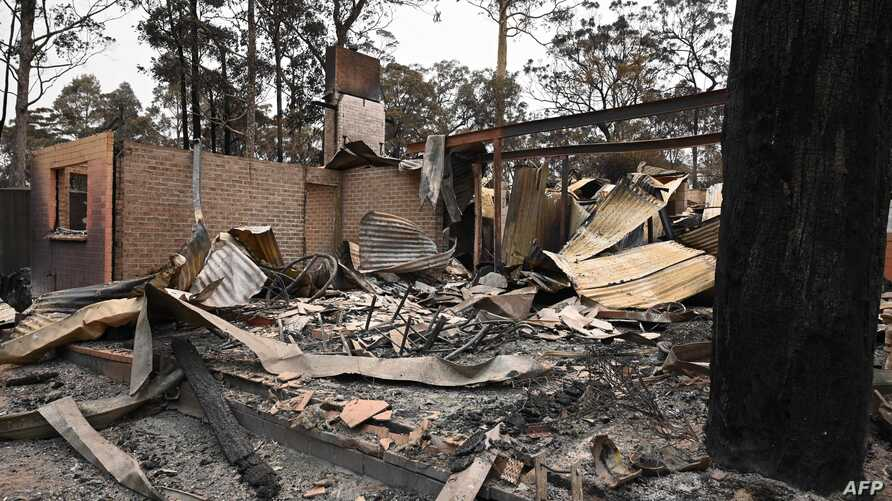 The remains of a house destroyed by a bushfire is seen just outside Batemans Bay in New South Wales on January 2, 2020. -…