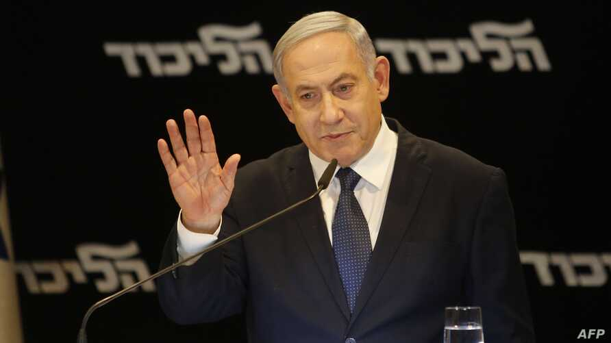 Israeli Prime Minister Benjamin Netanyahu speaks at a press conference regarding his intention to file a request to the Knesset…