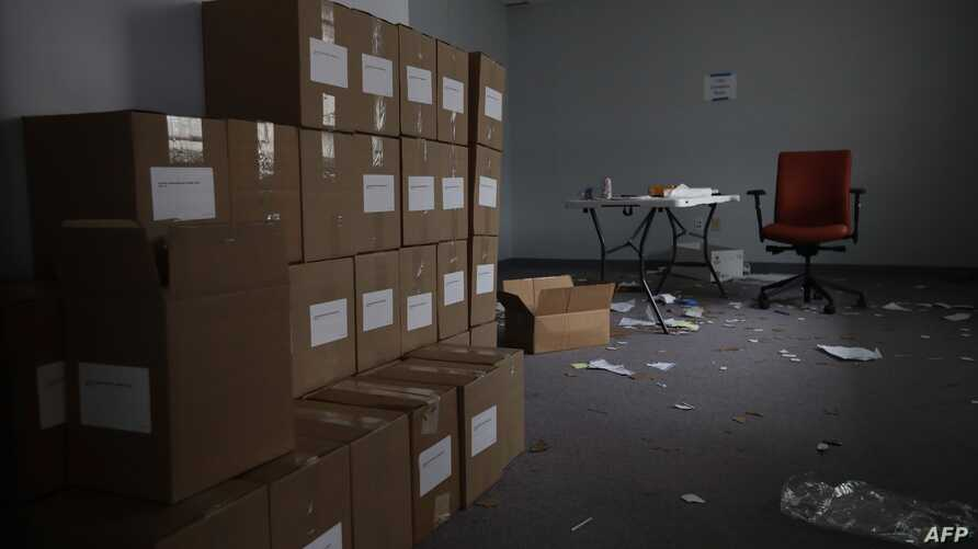 DES MOINES, IOWA - FEBRUARY 04: Boxes of voters registration forms are stacked in a space that the Iowa Democratic Party…