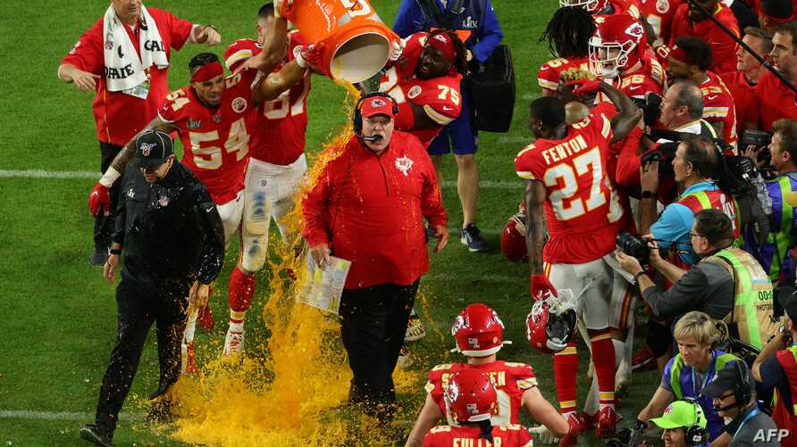 MIAMI, FLORIDA - FEBRUARY 02: Head coach Andy Reid of the Kansas City Chiefs gets a ice bath after defeating the San Francisco…
