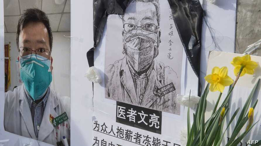 Chinese students and their supporters hold a memorial for Dr Li Wenliang, who was the whistleblower of the Coronavirus, Covid…