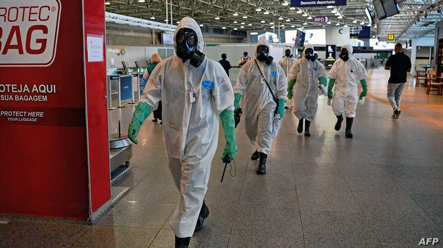 Navy soldiers are seen after carrying out a disinfection operation against the novel coronavirus COVID-19 at Tom Jobim Galeao…