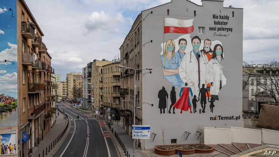 A mural paying tribute to the sacrifice of doctors, nurses and paramedics fighting with epidemic of the new coronavirus COVID…