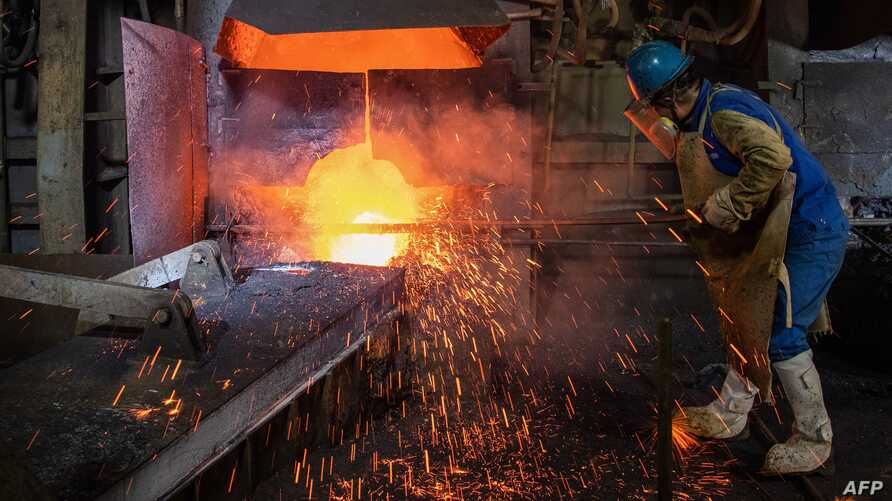 TOPSHOT - This photo taken on April 1, 2020 shows an employee working at a metal production plant in Huangshi in China's…