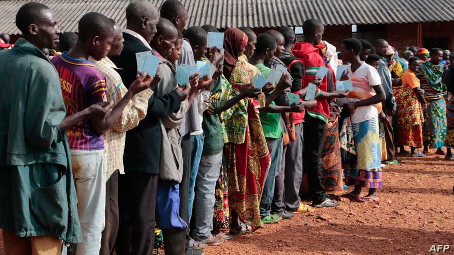 Burundians wait in a queue to vote during the presidential and general elections in Ngozi, northern Burundi, on May 20, 2020. …
