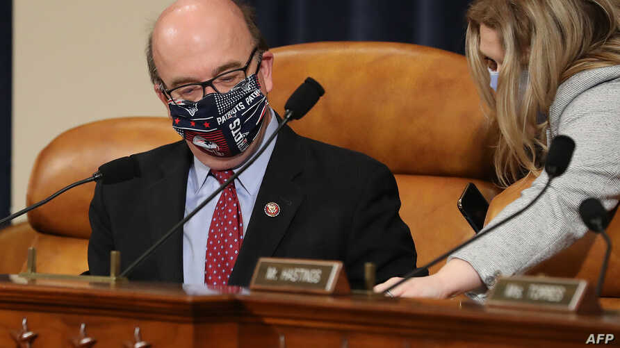 WASHINGTON, DC - MAY 14: House Rules Committee Chairman Jim McGovern (D-MA) wears a New England Patriots-themed face mask…