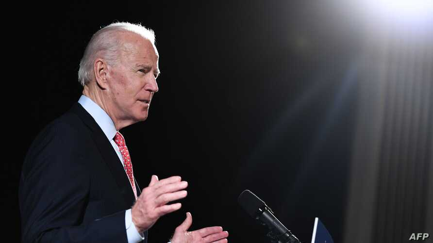 (FILES) In this file photo taken on March 12, 2020 former US Vice President and Democratic presidential hopeful Joe Biden…