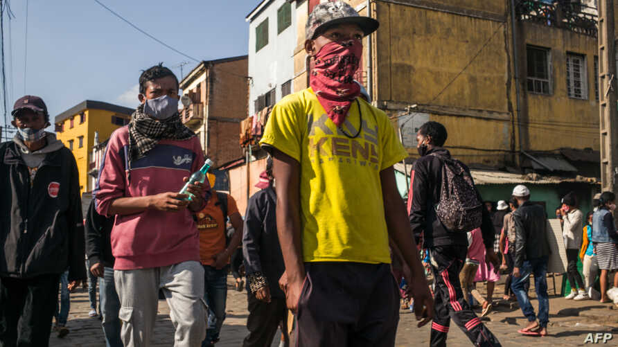 People walk in the streets of the Isotry district of Madagascar capital Antananarivo on May 16, 2020 where 16 people have been…