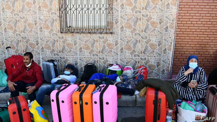 Moroccan citizens wait for their repatriation after being stranded in Spain due to the coronavirus crisis, on May 22, 2020, in…