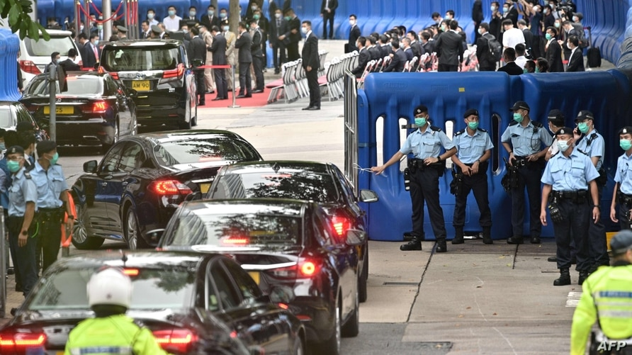 Guests drive past barriers near the Office for Safeguarding National Security of the Central People's Government in the Hong…