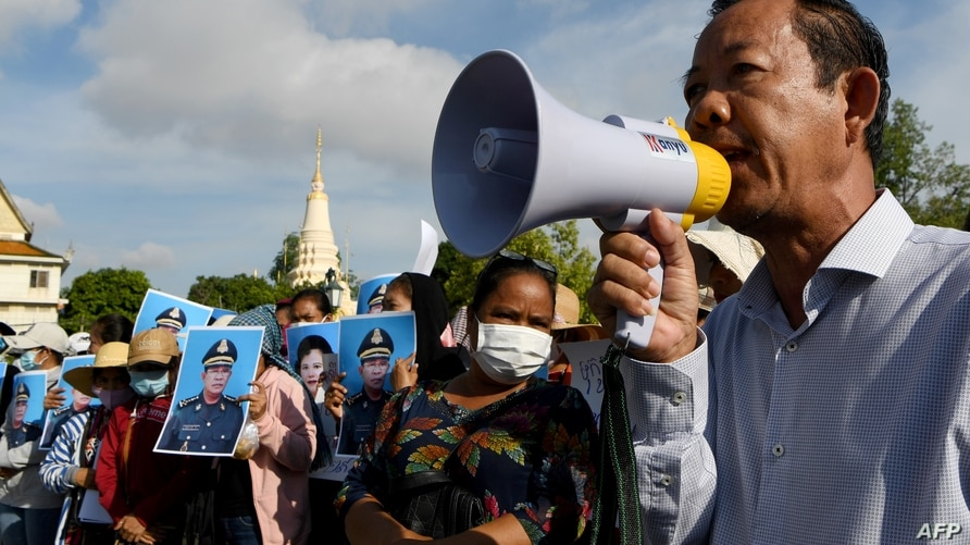 (FILES) In this file photo taken on July 29, 2020 Rong Chhun, president of Cambodia's Independent Teachers' Association, speaks…