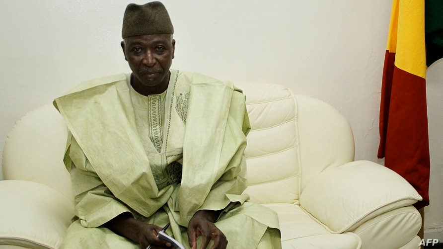 (FILES) In this file photo taken on May 28, 2014 Mali's newly appointed defence minister Bah Ndaw poses at the Defence ministry…