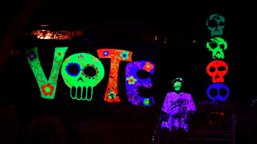 Halloween decorations urging people to vote in the upcoming presidential election are displayed in front of a home on October…