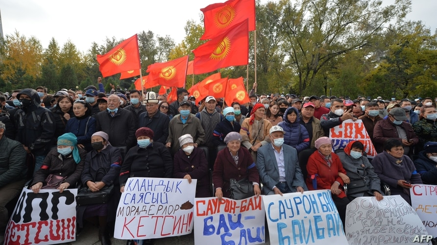 Supporters of former Kyrgyzstan President Almazbek Atambayev attend a rally in Bishkek on October 9, 2020. - Two large crowds…