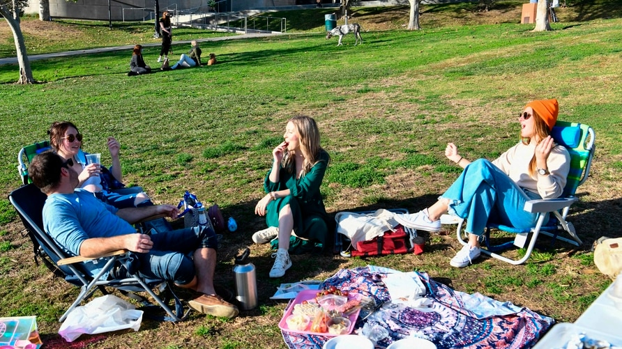 LOS ANGELES, CA - NOVEMBER 26: People gather at a picnic lunch in Pan Pacific Park during Thanksgiving on November 26, 2020 in…