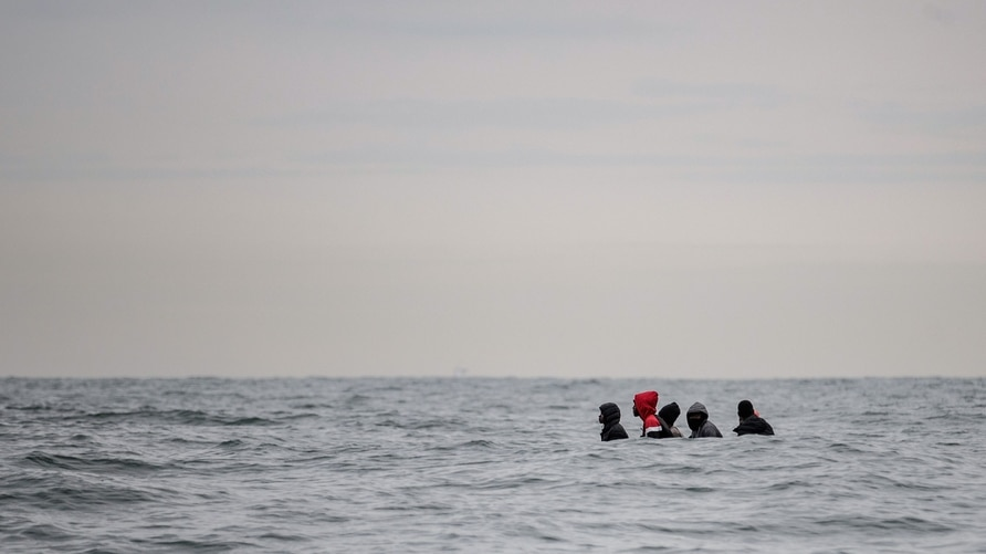 -- AFP PICTURES OF THE YEAR 2020 --  Migrants sit onboard a boat navigating in agitated waters between Sangatte and Cap Blanc…