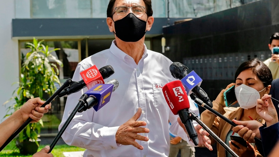 Peruvian former president Martin Vizcarra, impeached and ousted over corruption allegations, talks to the press outside his…
