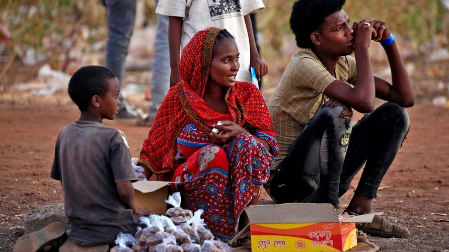 Ethiopian refugees who fled the fighting in Tigray Region are pictured at a border reception centre (Village 8) in Gedaref…